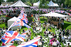 © Licensed to London News Pictures. 17/06/2014. Ascot, UK. The good weather attracts a large crowd to the bars.  Day one at Royal Ascot 17th June 2014. Royal Ascot has established itself as a national institution and the centrepiece of the British social calendar as well as being a stage for the best racehorses in the world. Photo credit : Stephen Simpson/LNP