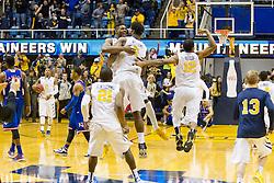 West Virginia players react after beating Kansas at the WVU Coliseum.