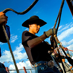 081807      Brian Leddy.Fernando Armstrong of White River, Ariz. readies his rope with rosin prior to the start of Saturday's Ramah Navajo Fair Rodeo. Armstrong was competing in the bull riding competition that evening.