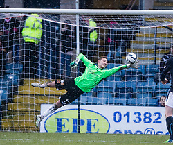 Motherwell's keeper Dan Twardzik saves from Dundee's Alex Harris. <br /> Dundee 4 v 1 Motherwell, SPFL Premiership played 10/1/2015 at Dundee's home ground Dens Park.