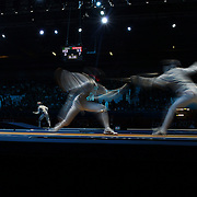 A blur of motion as Race Imboden, USA, (left) competes against Andrea Baldini, Italy, in the Men's Foil Individual event during the Fencing competition at ExCel South Hall during the London 2012 Olympic games. London, UK. 31st July 2012. Photo Tim Clayton