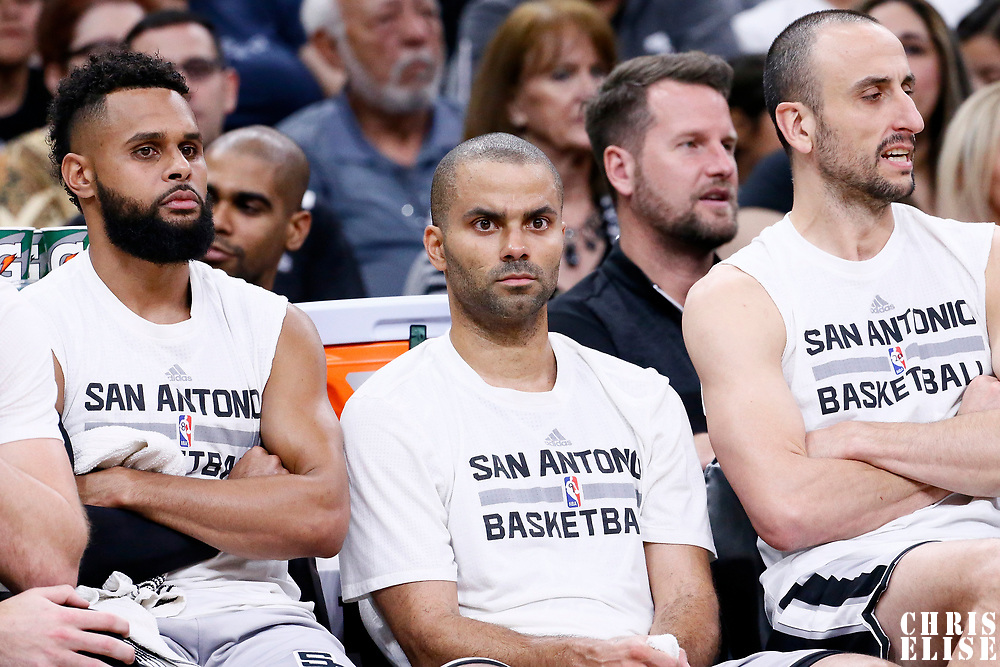 02 April 2017: San Antonio Spurs guard Patty Mills (8), San Antonio Spurs guard Tony Parker (9) and San Antonio Spurs guard Manu Ginobili (20) are seen on the bench during the San Antonio Spurs 109-103 victory over the Utah Jazz, at the AT&T Center, San Antonio, Texas, USA.