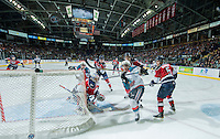KELOWNA, CANADA - MARCH 27: Dillon Dube #19 and Rodney Southam #17 of Kelowna Rockets keep their eye on the puck after a deflect shot on Eric Comrie #1 of Tri-City Americans on March 27, 2015 at Prospera Place in Kelowna, British Columbia, Canada.  (Photo by Marissa Baecker/Shoot the Breeze)  *** Local Caption *** Eric Comrie; Dillon Dube; Rodney Southam;