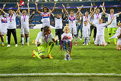 CARDIFF, WALES - Thursday, June 1, 2017: Olympique Lyonnais' goalkeeper Sarah Bouhaddi celebrates with a child in the trophy after winning the UEFA Champions League following a penalty-shoot out victory during the UEFA Women's Champions League Final between Olympique Lyonnais and Paris Saint-Germain FC at the Cardiff City Stadium. (Pic by David Rawcliffe/Propaganda)