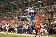 IRVING, TX - OCTOBER 23:  Cornerback Anthony Henry #42 of the Dallas Cowboys jumps high to deflect a pass interned for airborne wide receiver Plaxico Burress #17 of the New York Giants at Texas Stadium on October 23, 2006 in Irving, Texas. The Giants defeated the Cowboys 36-22. ©Paul Anthony Spinelli *** Local Caption *** Anthony Henry;Plaxico Burress