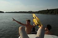 LSA member Yoshi Livo holding the Liberland flag on the Danube, showing Liberland.