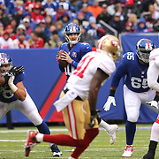 Quarterback Eli Manning, New York Giants, looks for an open receiver during the New York Giants V San Francisco 49ers, NFL American Football match at MetLife Stadium, East Rutherford, NJ, USA. 16th November 2014. Photo Tim Clayton
