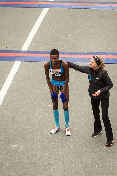 ING New York CIty Marathon: Diane Nukuri-Johnson, Burundi, greeted by race director Mary Wittenberg