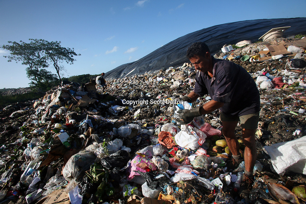 A man digs through trash at a dump called Magic Gardens, in San Andres, a small island in the Caribbean, on Thursday, January 24, 2008. The locals, who make up now just 30% of the population, claim that the island is now overpopulated, and starting to suffer the consequences from unchecked growth. (Photo/Scott Dalton).