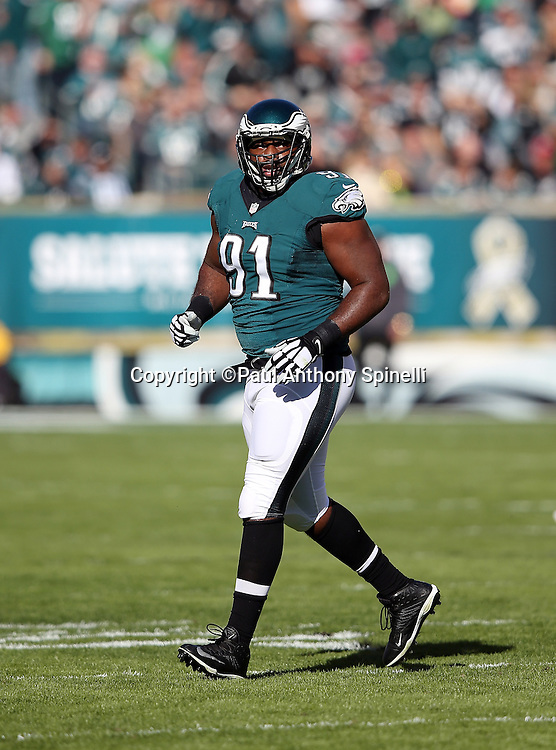 Philadelphia Eagles defensive end Fletcher Cox (91) jogs cross field in celebration after logging a first quarter sack during the 2015 week 10 regular season NFL football game against the Miami Dolphins on Sunday, Nov. 15, 2015 in Philadelphia. The Dolphins won the game 20-19. (©Paul Anthony Spinelli)