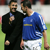 Partick Thistle v St Johnstone..30.08.05  Bells Cup<br />Owen Coyle has a laugh with David Hannah who scored the winning penalty<br /><br />Picture by Graeme Hart.<br />Copyright Perthshire Picture Agency<br />Tel: 01738 623350  Mobile: 07990 594431
