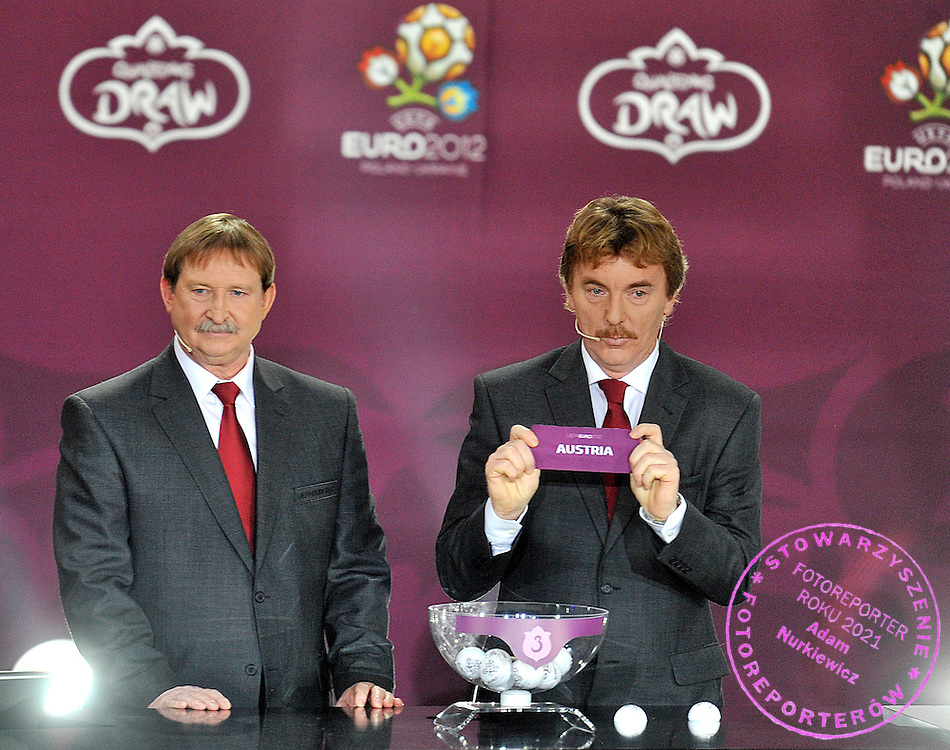 (L) ANDRZEJ SZARMACH AND (R) ZBIGNIEW BONIEK (BOTH POLAND) SHOW THE TICKET OF AUSTRIA DURING THE EUFA EURO 2012 QUALIFYING DRAW IN PALACE SCIENCE AND CULTURE IN WARSAW, POLAND..THE 2012 EUROPEAN SOCCER CHAMPIONSHIP WILL BE HOSTED BY POLAND AND UKRAINE...WARSAW, POLAND , FEBRUARY 07, 2010..( PHOTO BY ADAM NURKIEWICZ / MEDIASPORT )..PICTURE ALSO AVAIBLE IN RAW OR TIFF FORMAT ON SPECIAL REQUEST.