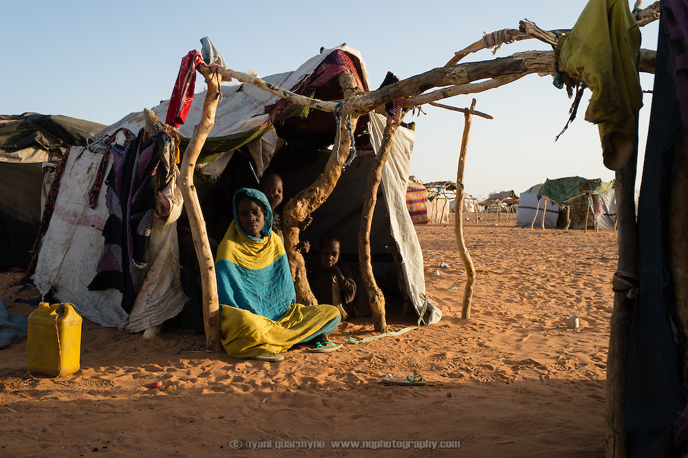 Fatima Mint Alhajj and her five children share this rough shelter seen at at the Mbera camp for Malian refugees in Mauritania on 11 March 2013. According to Fatima, when she was registered at the camp - on 26 February according to her refugee card - she was told there were no tents available.