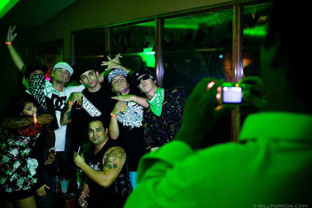 Hollywood Ray, owner of the Coko Bongo nightclub in Tijuana, Mexico, takes a picture of some guests in the VIP room on October 5, 2007.