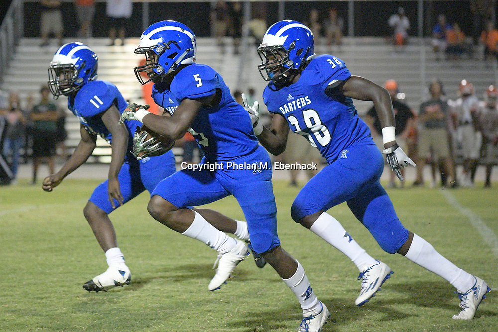 Apopka defensive back Anthony Fieldings runs after intercepting a pass against Orange City University during the second half of a spring high school football game in Apopka, Fla., Thursday, May 25, 2017. (Photo by Phelan M. Ebenhack)