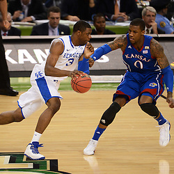 Apr 2, 2012; New Orleans, LA, USA; Kentucky Wildcats forward Terrence Jones (3) dribbles the ball as Kansas Jayhawks forward Thomas Robinson (0) defends during the first half in the finals of the 2012 NCAA men's basketball Final Four at the Mercedes-Benz Superdome. Mandatory Credit: Derick E. Hingle-US PRESSWIRE