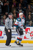 KELOWNA, CANADA - JANUARY 21: Linesman, Cody Wanner escorts Carsen Twarynski #18 of the Kelowna Rockets to the penalty box against the Portland Winterhawks on January 21, 2017 at Prospera Place in Kelowna, British Columbia, Canada.  (Photo by Marissa Baecker/Shoot the Breeze)  *** Local Caption ***