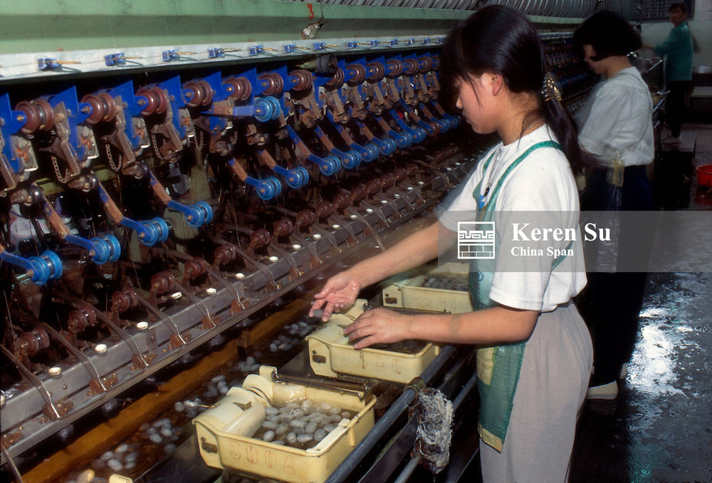 Drawing silk threads from silk cocoons in the silk factory, Hangzhou, Zhejiang Province, China