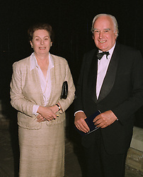 SIR GERARD VAUGHAN MP & LADY VAUGHAN at a party on April 4th 1997.LXJ 14