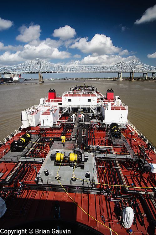 GNO bridge (Crescent City Connection) New Orleans. ATB, Legacy and barge 750-1, Crowley Maritime. Transporting primium and regular grade gasoline from Marathon Oil in Garryville, La. to Port Everglades and Tampa Florida.