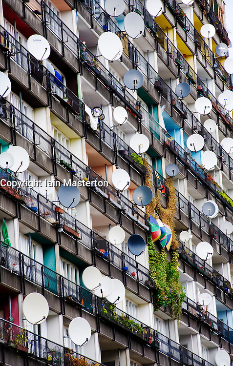 Many satellite dishes on apartment building at Pallastrasse in Berlin Germany