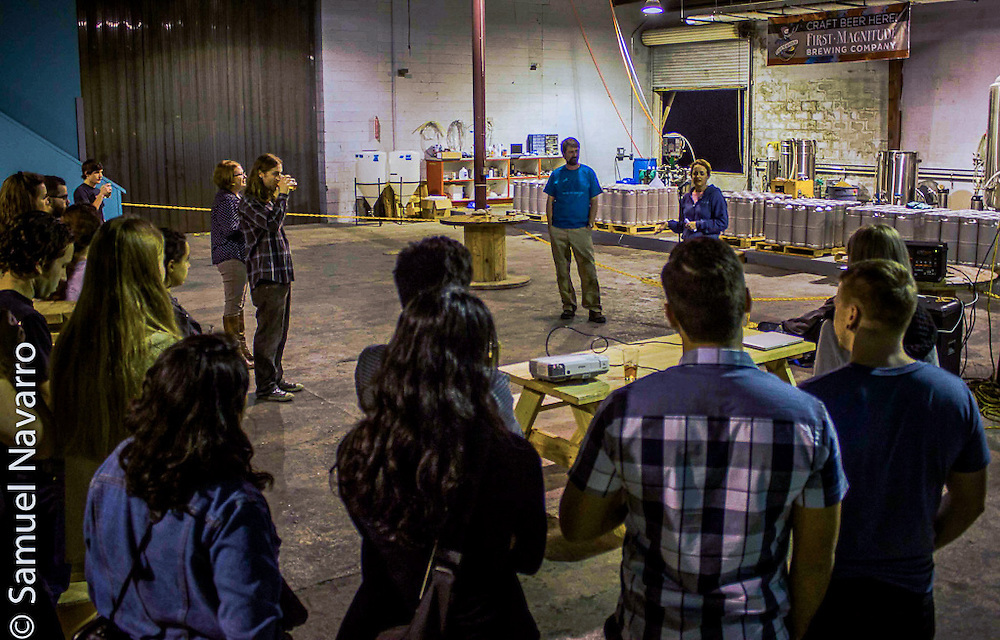 In front of a crowd of University of Florida design students hosting a fundraiser event at FM, Denny gives a speech about the history of the brewery and the story behind its foundation Wednesday, February 4, 2015. (photo by Samuel Navarro)