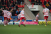 Doncaster Rovers Midfielder Tommy Rowe (10) celebrates as he scores a goal 2-0 during the The FA Cup match between Doncaster Rovers and Scunthorpe United at the Keepmoat Stadium, Doncaster, England on 3 December 2017. Photo by Craig Zadoroznyj.