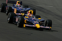 Patrick Carpentier and Alex Barron race at the Twin Ring Motegi, Japan Indy 300, April 30, 2005