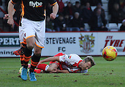 Stevenage's Lee Barnard goes down after a challenge during the Sky Bet League 2 match between Stevenage and Exeter City at the Lamex Stadium, Stevenage, England on 20 December 2014. Photo by Kieran Clarke.