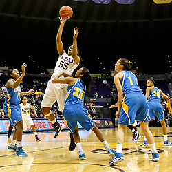 December 13, 2011; Baton Rouge, LA; LSU Lady Tigers forward LaSondra Barrett (55) shoots over UCLA Bruins guard Rebekah Gardner (35) during the first half of a game at the Pete Maravich Assembly Center.  Mandatory Credit: Derick E. Hingle-US PRESSWIRE