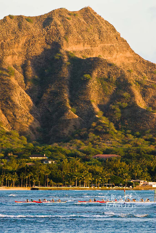 Outrigger canoe paddlers, Diamond Head in bg, Waikiki, Oahu, Hawaii