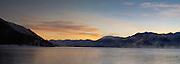 Sunrise over Lake Tekapo, New Zealand, with the Two Thumbs Range in the background.