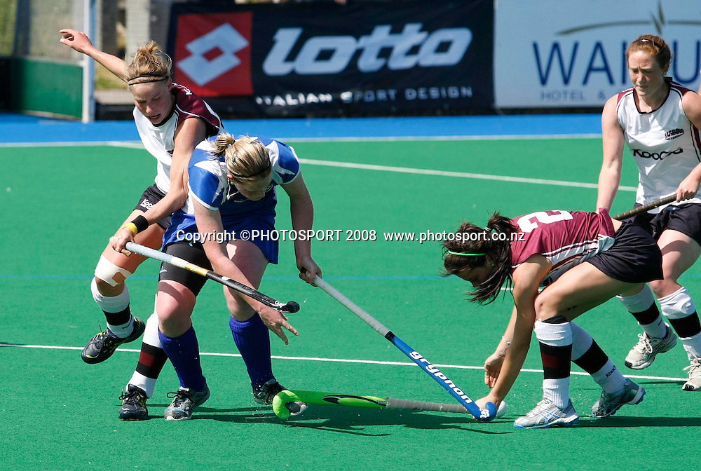Auckland's Katie Glynn is tackled by North Harbour's Anne-Sophie Van Regemortal (L) and Natasha Fitzsimons (R). Hockey, National Hockey League Women's Final, Auckland v North Harbour. Lloyd Elsmore Park, Auckland, New Zealand, Sunday 28 September.