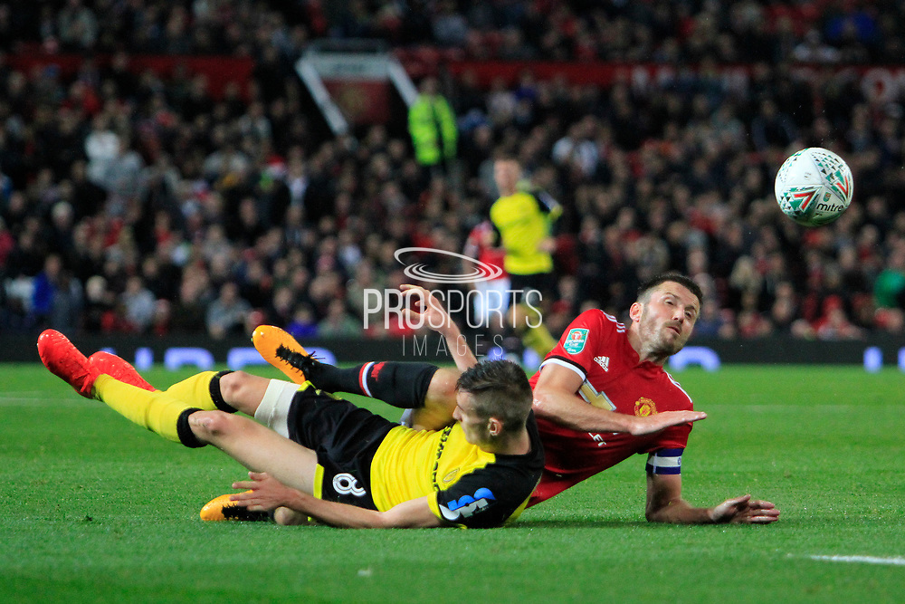Burton Albion midfielder Matthew Lund (8) and Manchester United midfielder Michael Carrick (16) collide during the EFL Cup match between Manchester United and Burton Albion at Old Trafford, Manchester, England on 19 September 2017. Photo by Richard Holmes.