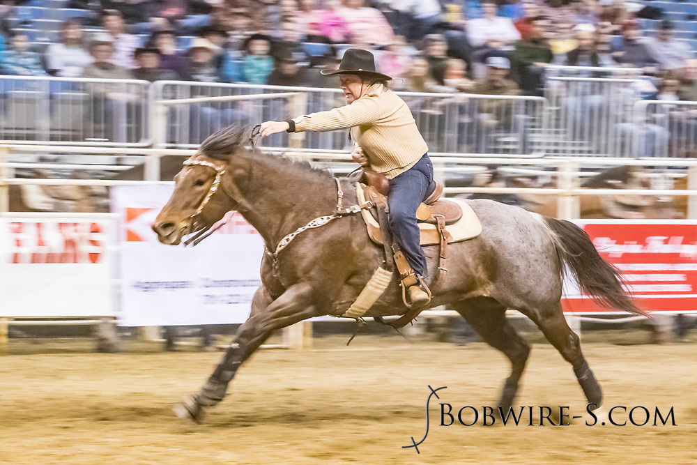 Cindy Baltezore makes her barrel run at the Bismarck Rodeo on Friday, Feb. 2, 2018. She ran an 13.26.