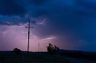 Cloud-to-cloud lightning in sky over power lines, © 2014 David A. Ponton