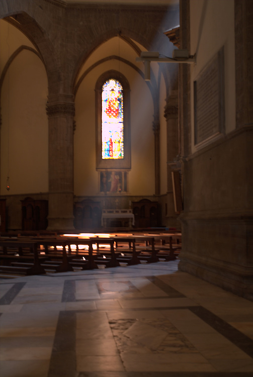 Shaft of light in church in Rome, Italy