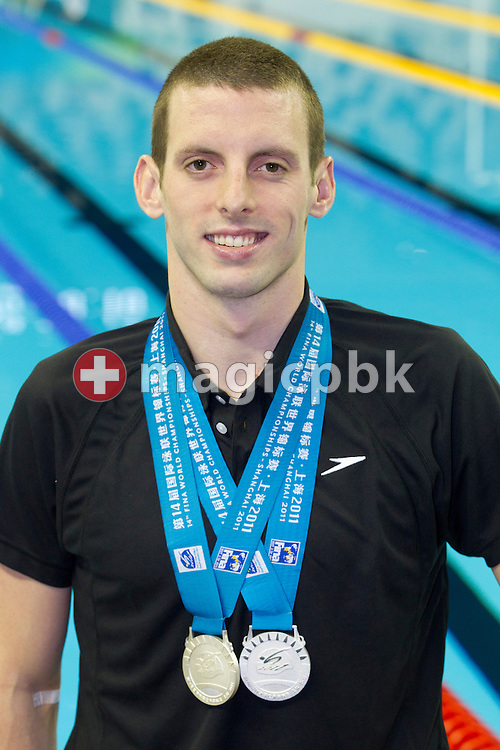 Ryan COCHRANE of Canada pose with his two silver medals won in the men's 800m and 1500m Freestyle Finals during the 14th FINA World Aquatics Championships at the Oriental Sports Center in Shanghai, China, Sunday, July 31, 2011. (Photo by Patrick B. Kraemer / MAGICPBK)