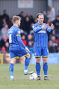 Dannie Bulman of AFC Wimbledon & Jake Reeves of AFC Wimbledon during AFC Wimbledon and York City at the Cherry Red Records Stadium, Kingston, England on 19 March 2016. Photo by Stuart Butcher.