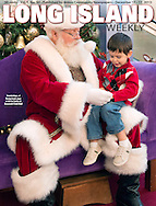 Cover Page Photo by Ann Parry; Long Island Weekly published by Anton News.<br /> Nov. 21, 2012 - Garden City, New York, U.S. - Santa Claus gets a visit from PATRICK HERR, 3 1/2, from Hempstead, at Roosevelt Field shopping mall in Long Island. Mom JULIANA CARREON and ISMAEL CARREON took him to visit the jolly man.