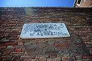 """Street sign reads """"Vetreria La Fenice Di Albertini"""" in Murano, Venice, Italy"""