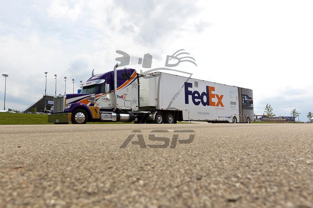 KANSAS CITY, KS - APR 19, 2012:  The FedEx hauler waits to park  for the STP 400 at the Kansas Speedway in Kansas City, KS.