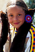 THIS PHOTO IS AVAILABLE FOR WEB DOWNLOAD ONLY. PLEASE CONTACT US FOR A LARGER PHOTO. Native American Indian girl with fur braid covers.  Close up.  MR