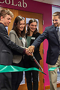 (Left to right) Ben Bowald, a senior in management information systems and business analytics; Faith Voinovich, a student trustee on the Boards of Trustees and junior in chemical engineering; Winter Wilson, a university innovation fellow and a junior in environmental studies and journalism; and Drew Stroud, a senior in mechanical engineering, particpate in the ribbon cutting at the grand opening for the new CoLab, Ohio University's hub of innovation and entrepreneurial activities, on the third floor of the Vernon Alden Library, October 18, 2018. (Photo by Stephen Zenner/Ohio University Libraries)