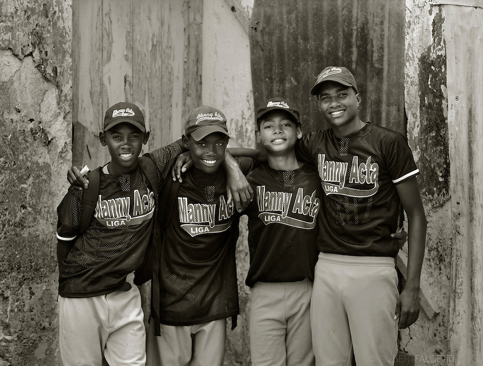 Consuelo, Dominican Republic- A group of young ball players, whose parents work in the sugarcane fields surrounding the village of Consuelo, are part of the Manny Acta Liga. Acta is a former player and manager in the Major Leagues. The children, born to Haitian parents living and working in the bateyes, will have their citizenship revoked after a ruling by the Constitutional Court in the Dominican Republic. The ruling could affect as many as 250,000 people in the Dominican Republic making it challenging for them just to live as before. It will  impede the right to education, to work, to legally marry, to register their children, to open bank accounts and also to leave the country that now rejects them, because they cannot obtain or renew their passports.  (Photo by Robert Falcetti)