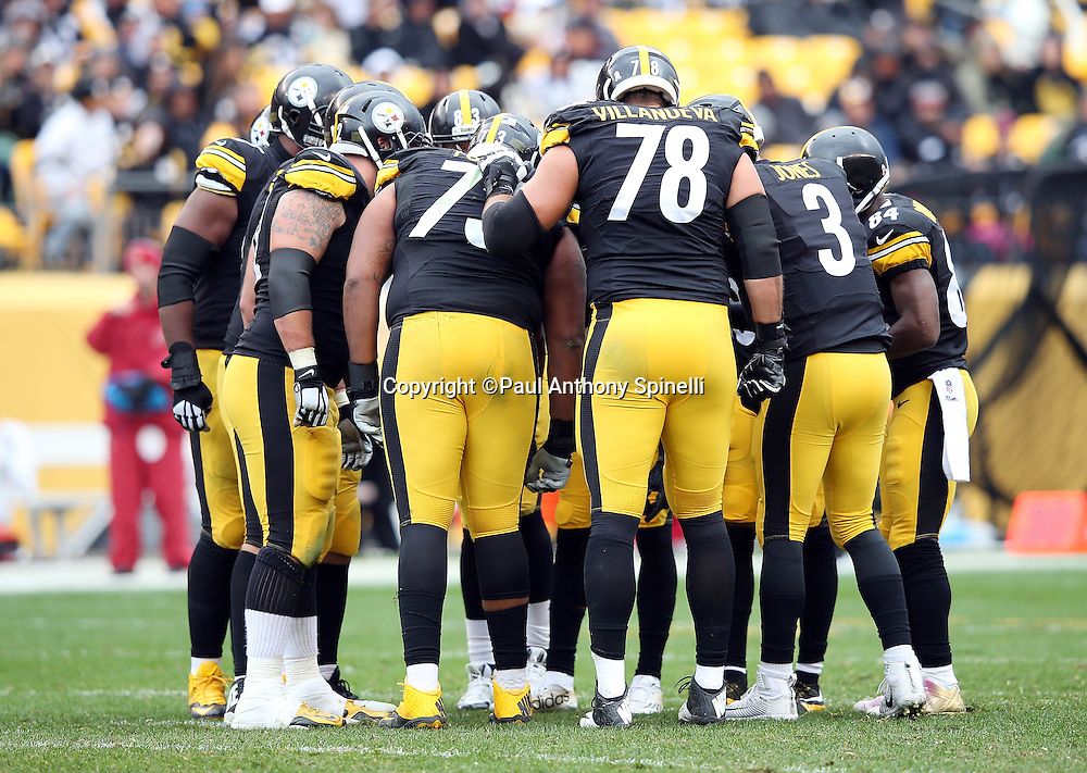 The Pittsburgh Steelers offense huddles during the 2015 NFL week 6 regular season football game against the Arizona Cardinals on Sunday, Oct. 18, 2015 in Pittsburgh. The Steelers won the game 25-13. (©Paul Anthony Spinelli)