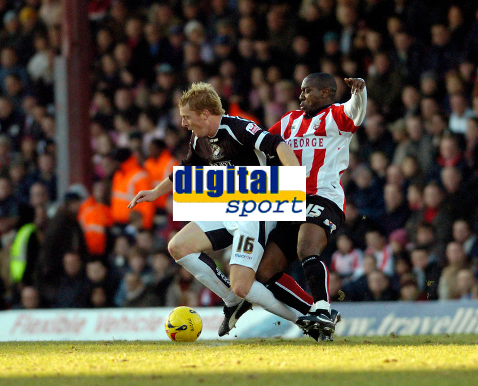 Photo: Leigh Quinnell.<br /> Brentford v Swansea City. Coca Cola League 1.<br /> 26/12/2005. Swanseas Garry Monk comes under attack from Brentfords Isaiah Rankin.