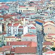 Perspective of Lisbon downtown with 25 Abril bridge on the background