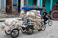Bicitaxi with trailer hauling biscuits in Holguin,Cuba.