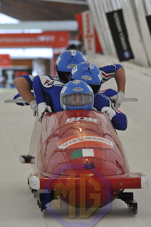 16 December 2007:  The Italy 2 four-man bobsled driven by Fabrizio Tosini with Gianluca Rebajolo, Andreas Mayrl and brakeman Danilo Santarsiero compete at the FIBT World Cup 4-Man bobsled competition on December 16, 2007 at the Olympic Sports Complex in Lake Placid, NY.  The Russia 2 sled driven by Alexandr Zubkov won the race with a time of 1:48.79.